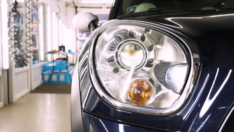 After professional polishing, ceramics and car washes show headlights on new cars. Concept of: Auto Service, Different Colors, Car stock photos