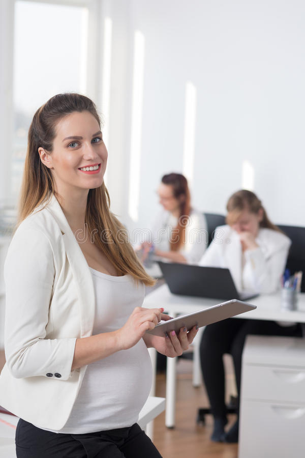 Professional pregnant woman at work royalty free stock images