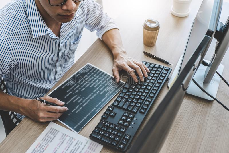 Professional programmer working at developing programming and website working in a software develop company office, writing codes stock image