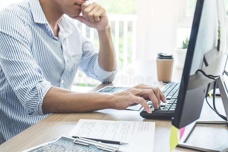 Professional programmer working at developing programming and website working in a software develop company office, writing codes royalty free stock images