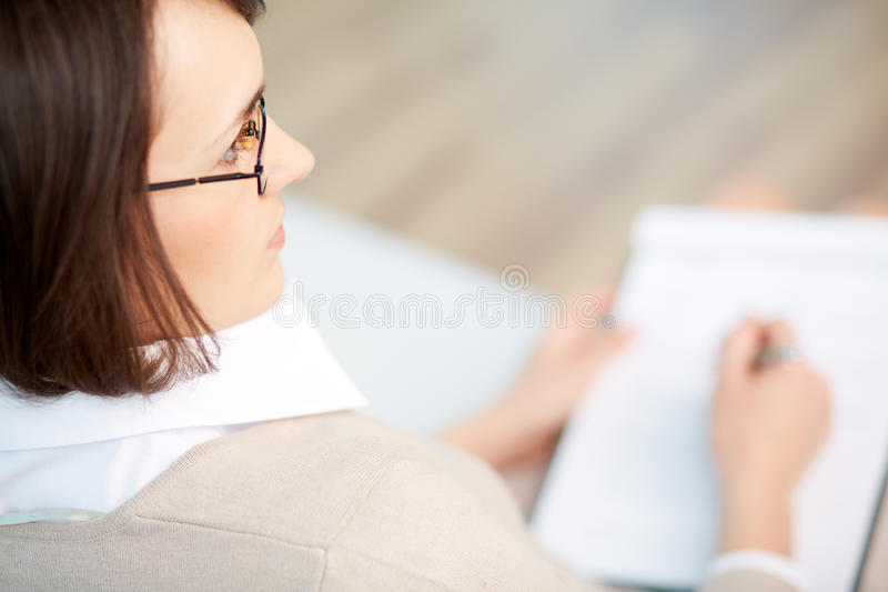 Professional psychiatrist. Keeping record during therapy session stock photos