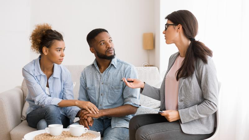 Couple Therapist Counselling African American Spouses In Office stock images