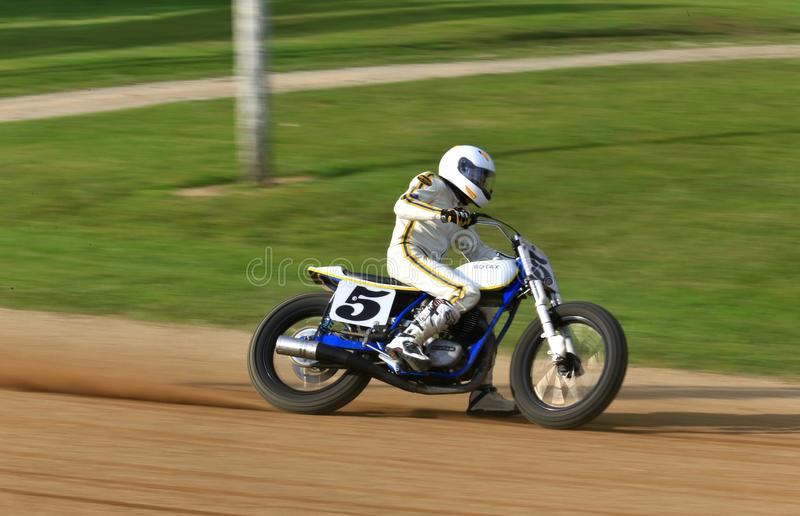 Professional Racer in action. Vintage motorcycle racer fights for the trophy at the vintage motorcycle racing event on the dirt oval flat track speedway, Ashland royalty free stock photo