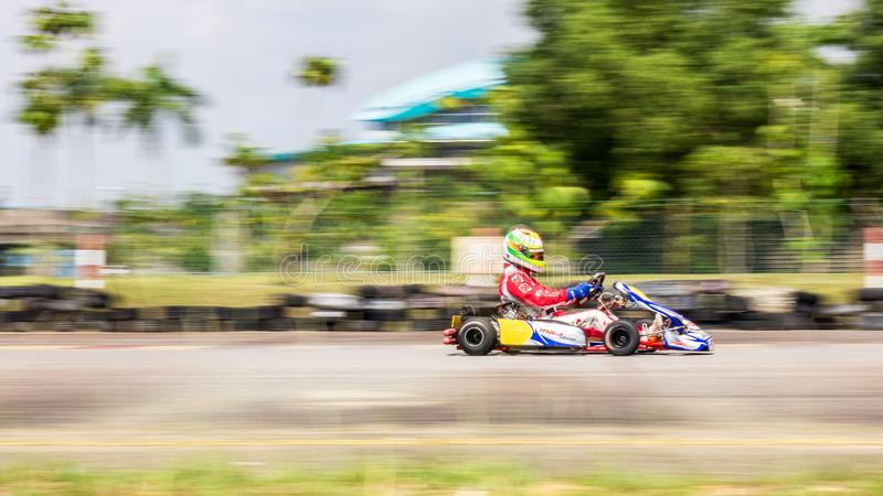 Professional racer racing on a race track with his go-kart stock photography