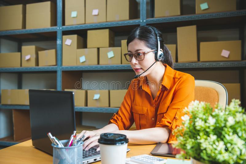 Professional receptionist is wearing headset. Talking to client and helping them to solve their online shop problem royalty free stock photos