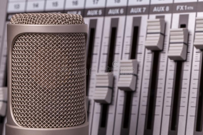 Professional recording microphone with studio audio mixer in the stock photos