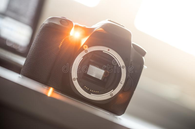 Professional camera: Reflex camera with open sensor. Professional reflex camera on a table, camera sensor, photography, photographer, lens, digital, review royalty free stock photo