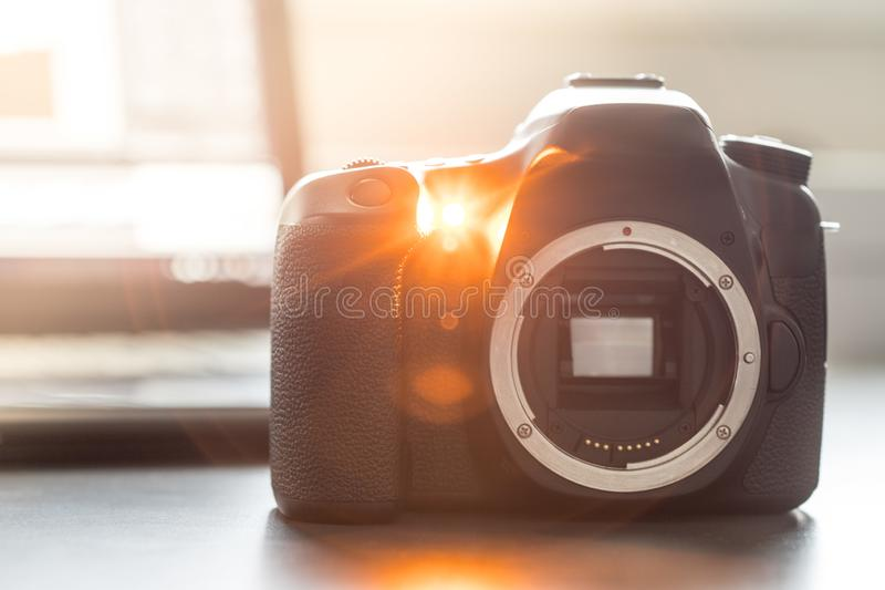 Professional camera: Reflex camera with open sensor. Professional reflex camera on a table, camera sensor, photography, photographer, lens, digital, review royalty free stock photography