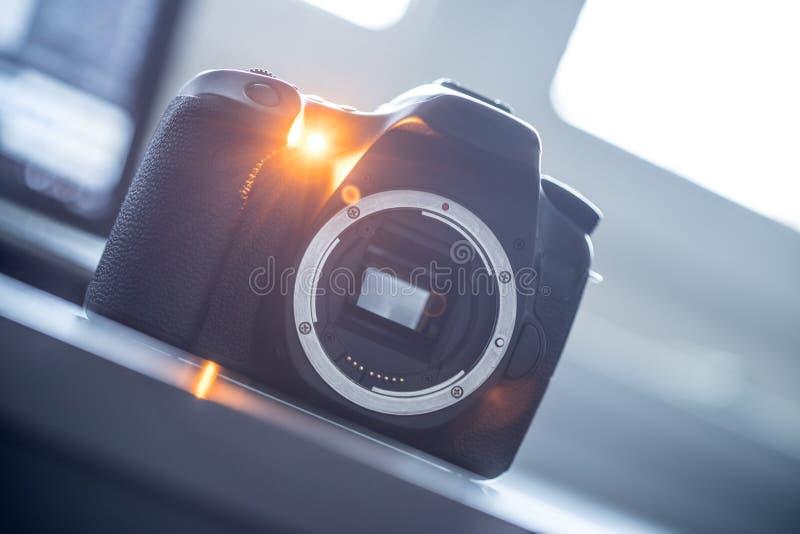 Professional camera: Reflex camera with open sensor. Professional reflex camera on a table, camera sensor, photography, photographer, lens, digital, review stock image