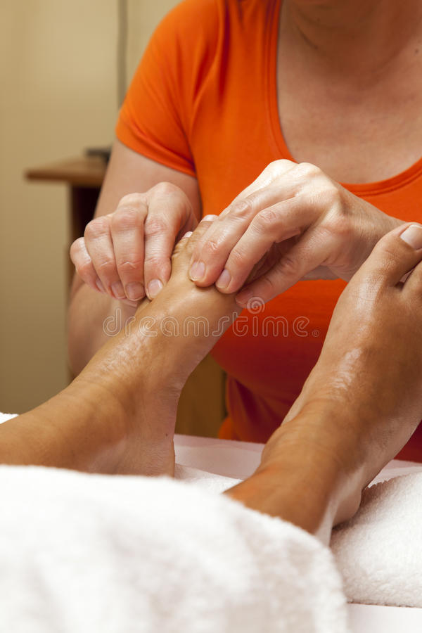 Professional relaxing foot massage, various techniques royalty free stock image