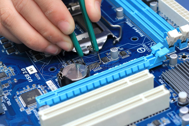 Professional repair of a circuit stock photography