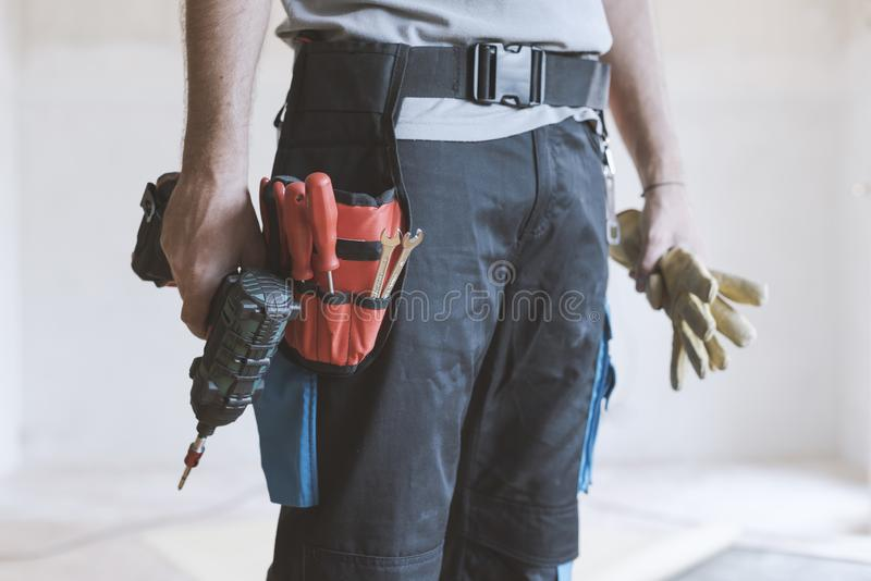 Professional repairman standing and holding a drill stock photos
