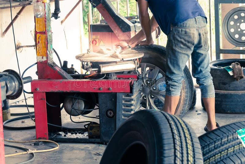 Professional repairman to repair the car wheels stock images