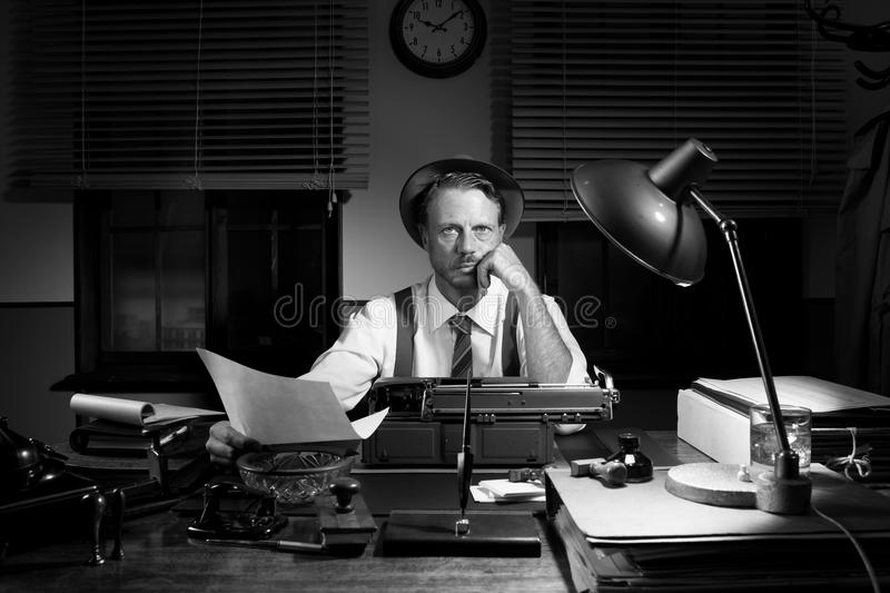 Professional reporter proofreading his text royalty free stock photos