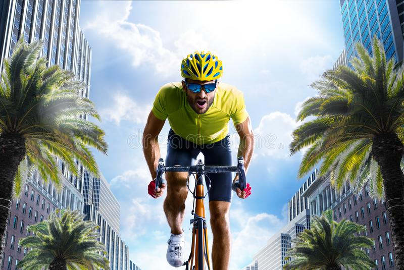 Professional road bicycle racer in action stock image