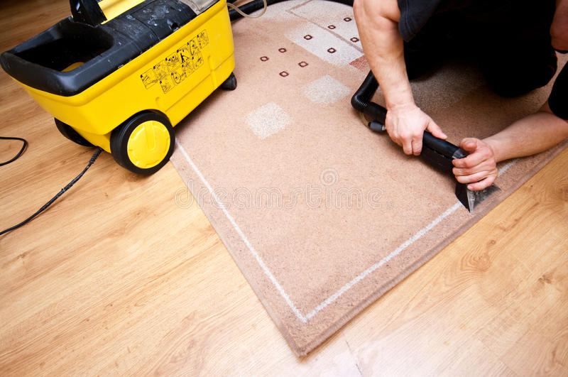 Professional rug cleaner at work stock photos