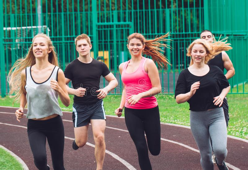 Professional runners running on a race track royalty free stock photo