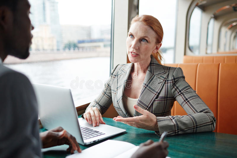 Negotiating with business partner stock photos