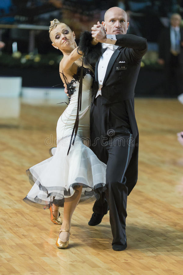 Download Professional Senior Dance Couple Performs European Standard Program On The WDSF Baltic Grand Prix-2106 Championship Editorial Photography - Image: 83707122