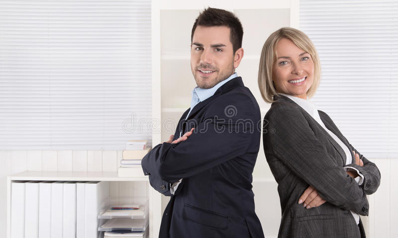 Professional senior and junior business team in portrait in the. Professional senior and junior business team in portrait at the office with white background royalty free stock photos