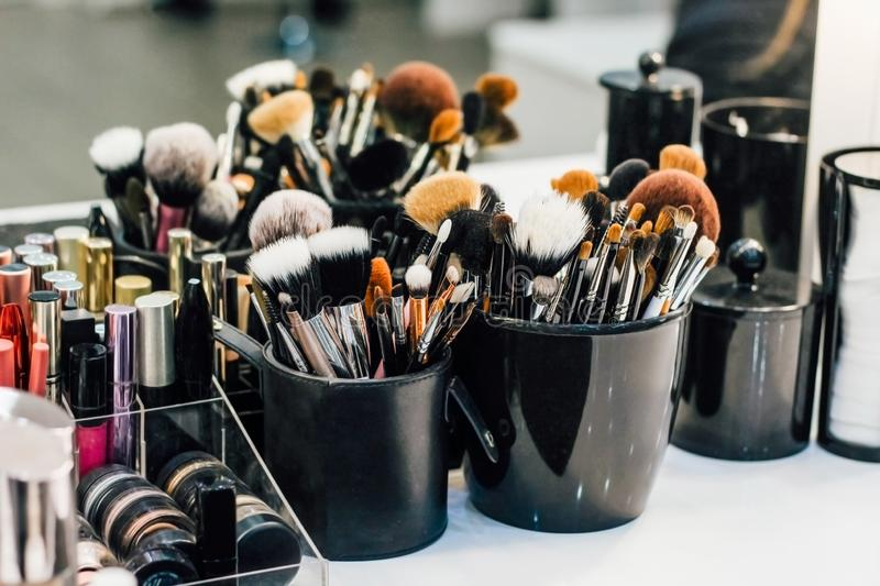 Professional set of make-up brushes ready to work. Cosmetic Close-up brush, powder, set of different objects for makeup artist and cosmetics stock photography