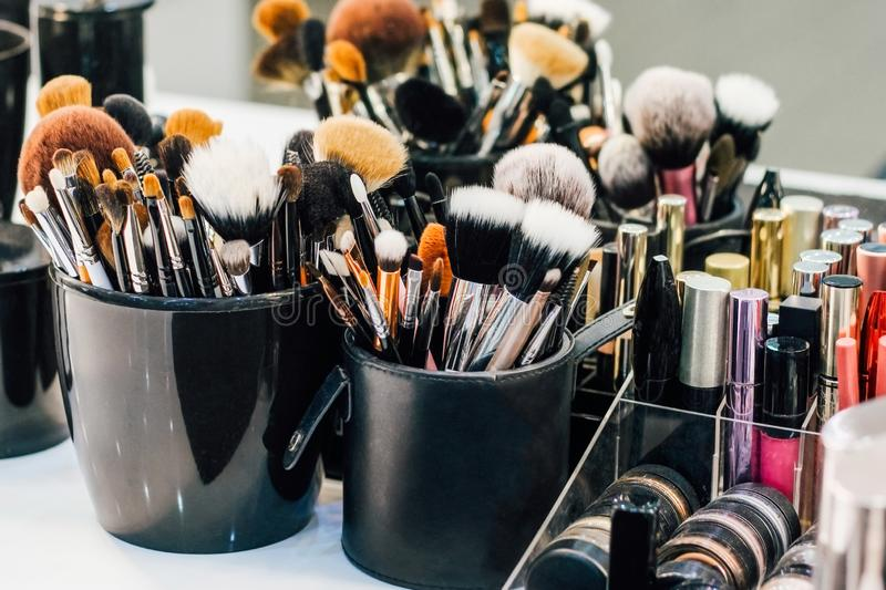 Professional set of make-up brushes ready to work. Cosmetic Close-up brush, powder, set of different objects for makeup artist and cosmetics royalty free stock images