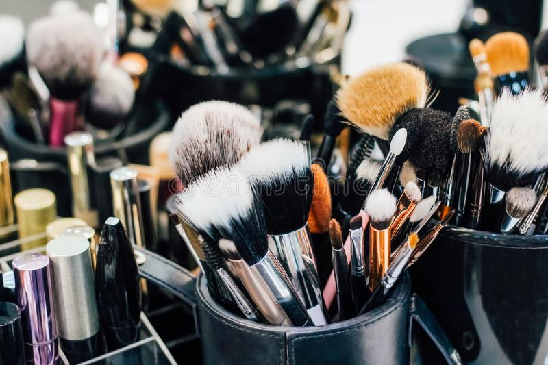 Professional set of make-up brushes ready to work. Cosmetic Close-up brush, powder, set of different objects for makeup artist and cosmetics stock images