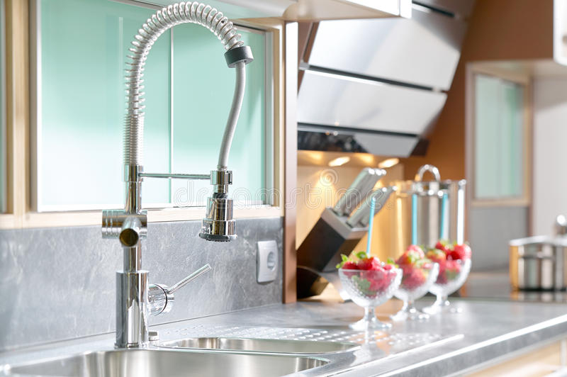 Professional single lever faucet in modern kitchen royalty free stock photo