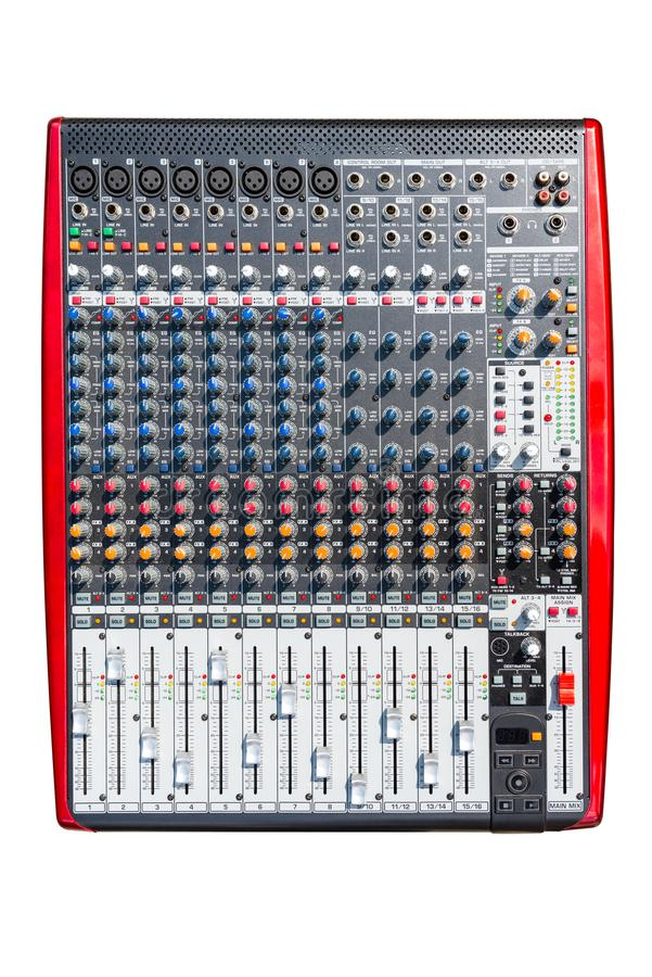 A professional sixteen input sound mixer with many adjustments, isolated on a white background with a clipping path. stock images