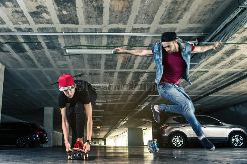 Professional skateboarder jumps in the subway stock image