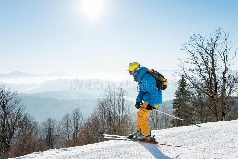 Professional skier enjoying skiing in mountains on sunny winter day on the winter resort. Professional skier enjoying skiing in mountains on a sunny winter day stock photos