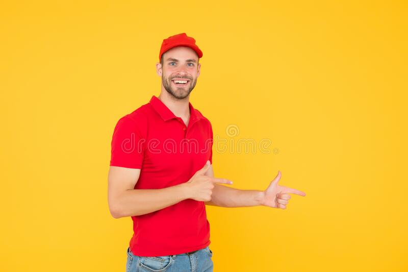 Professional smiling male employee in cap. portrait of smiling deliveryman. Delivery man in red uniform workwear. his. First job. part-time job for student. e stock image