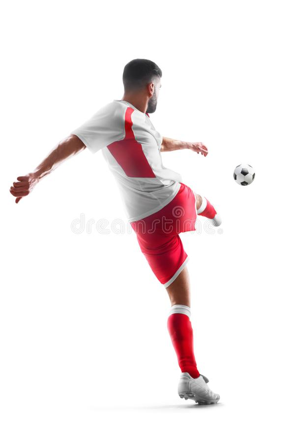 Professional soccer player in action. Back view. Isolated in white background royalty free stock photos