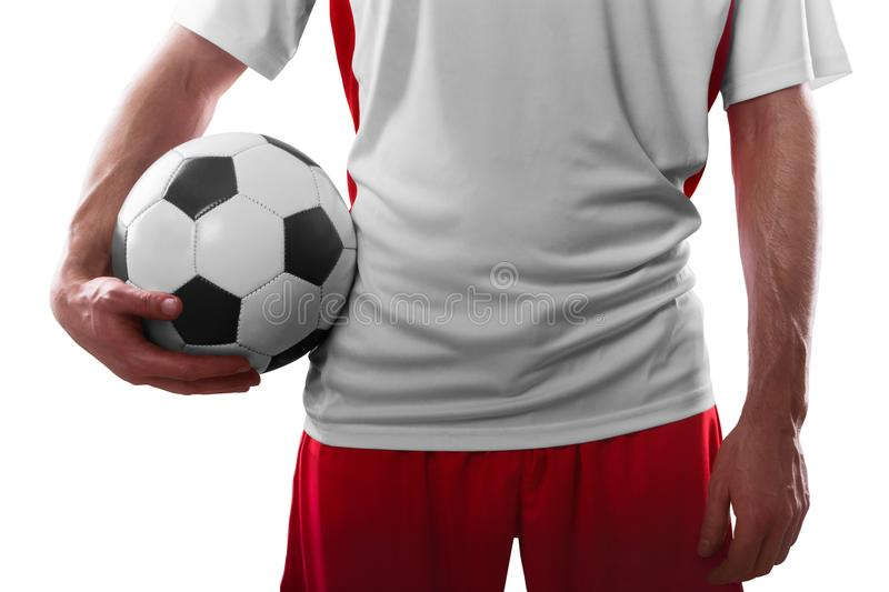 Professional soccer player holding soccer ball. Isolated on white background royalty free stock photos