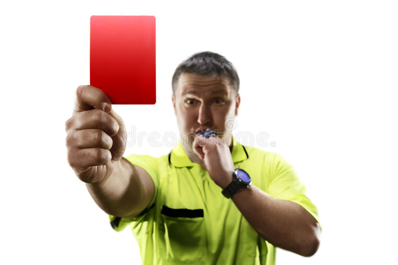 Professional soccer referee giving the red card isolated. Angry professional soccer referee is giving the red card on white background stock images