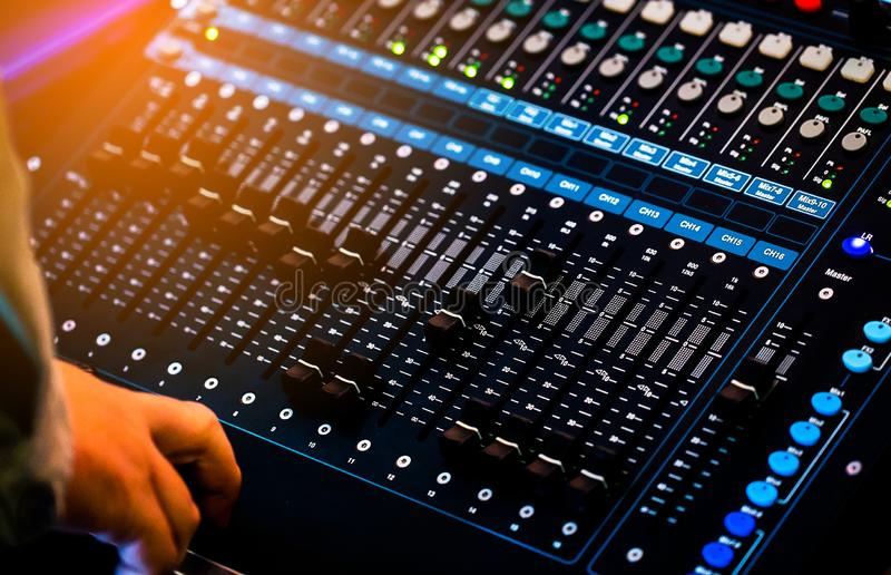 Professional sound and audio mixer control panel with buttons and sliders. Adjusting background bass board broadcast broadcasting channel closeup concert royalty free stock photography
