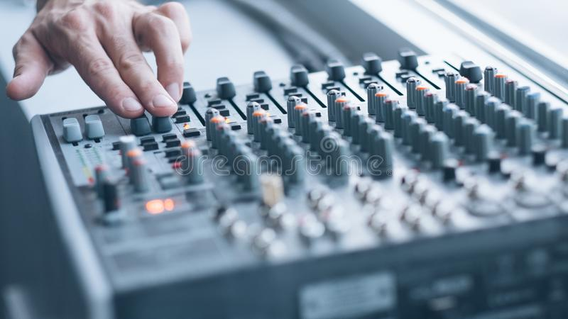 Professional sound console man mixing tracks royalty free stock image
