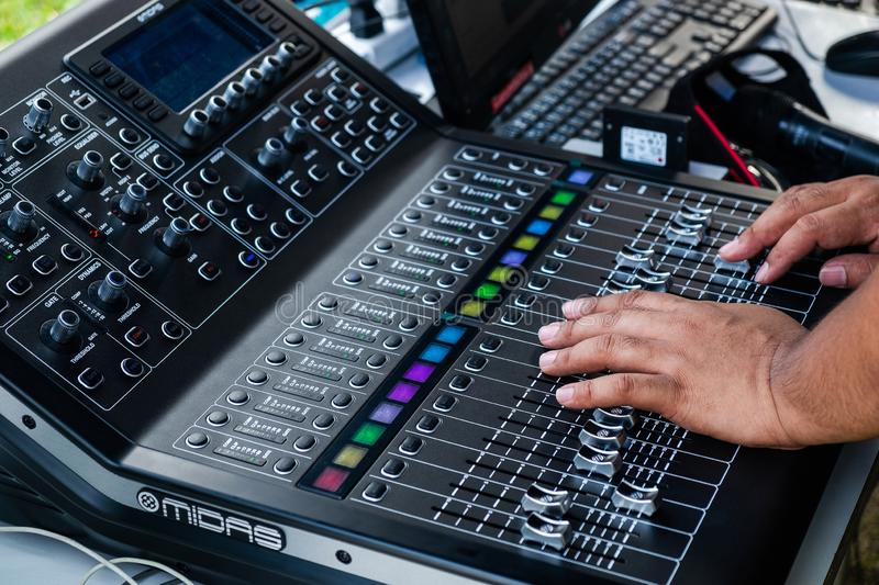 Professional Sound Engineer Adjust Sound with Midas Sound Mixer Equipment royalty free stock photography