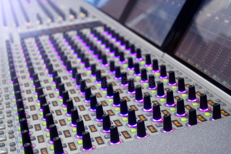 Professional sound engineer`s console. Remote control for the sound engineer. Mixing consoles. Remote concert sound engineer. stock image