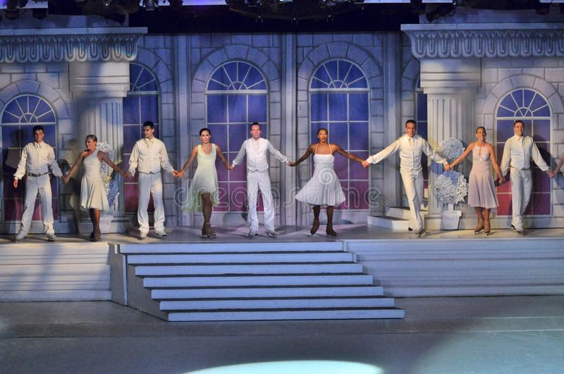 Farewell. Professional sportsmans ice skaters performing in an ice show production onboard cruise ship Adventure of the Seas stock images