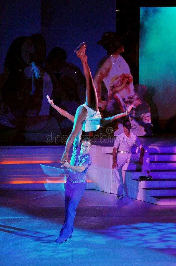 Ice show spectacular. Professional sportsmans ice skaters performing in an ice show production onboard cruise ship Adventure of the Seas royalty free stock images