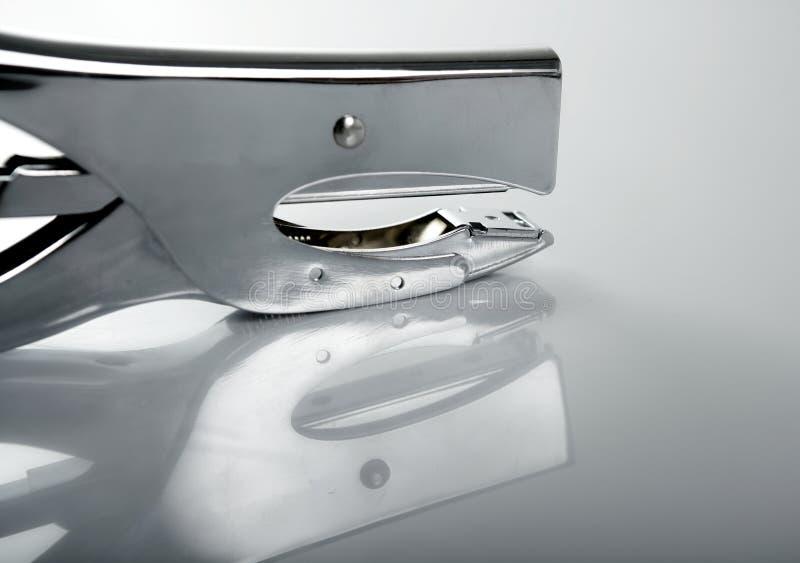 Professional stapler, chrome reflex royalty free stock photography