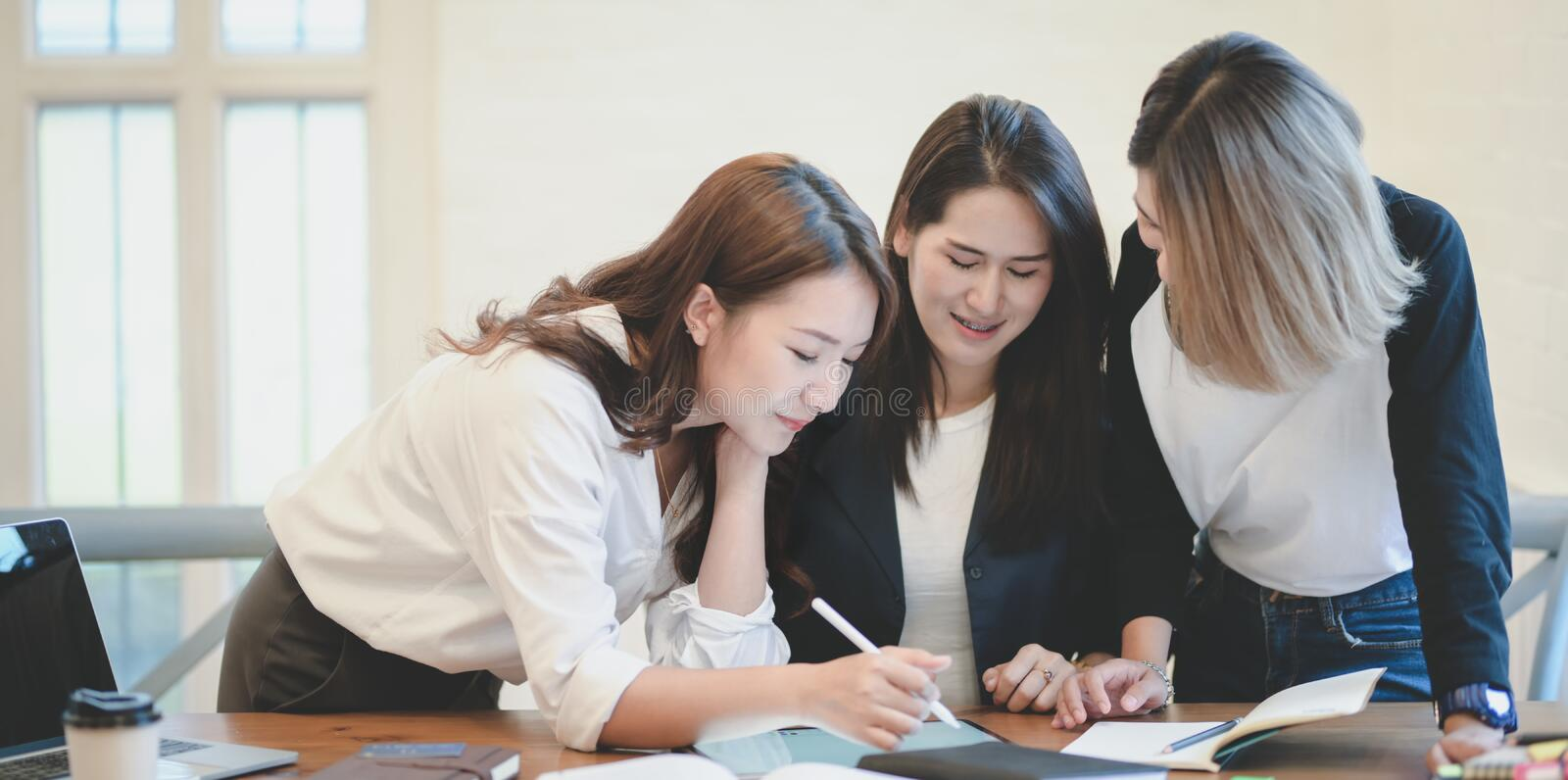 Professional startup team brainstorming the plan together with positive attitude royalty free stock images