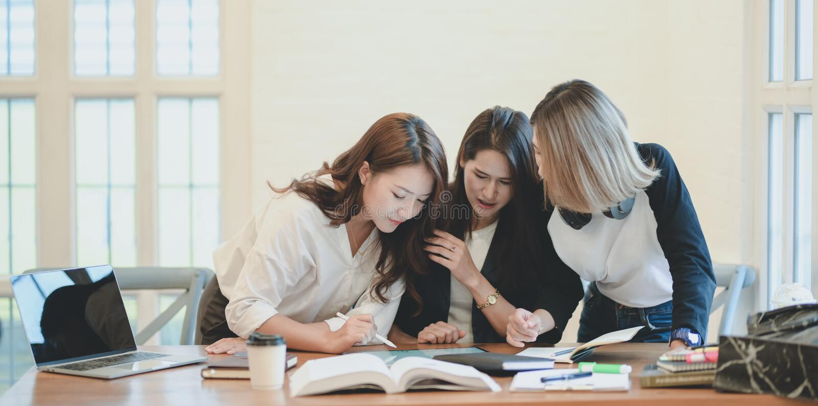 Professional startup team brainstorming the plan together with positive attitude. In modern office room stock photos