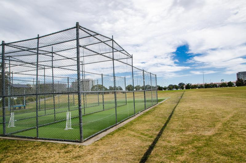 Professional Steel Cricket Cage on the green grass field. royalty free stock images