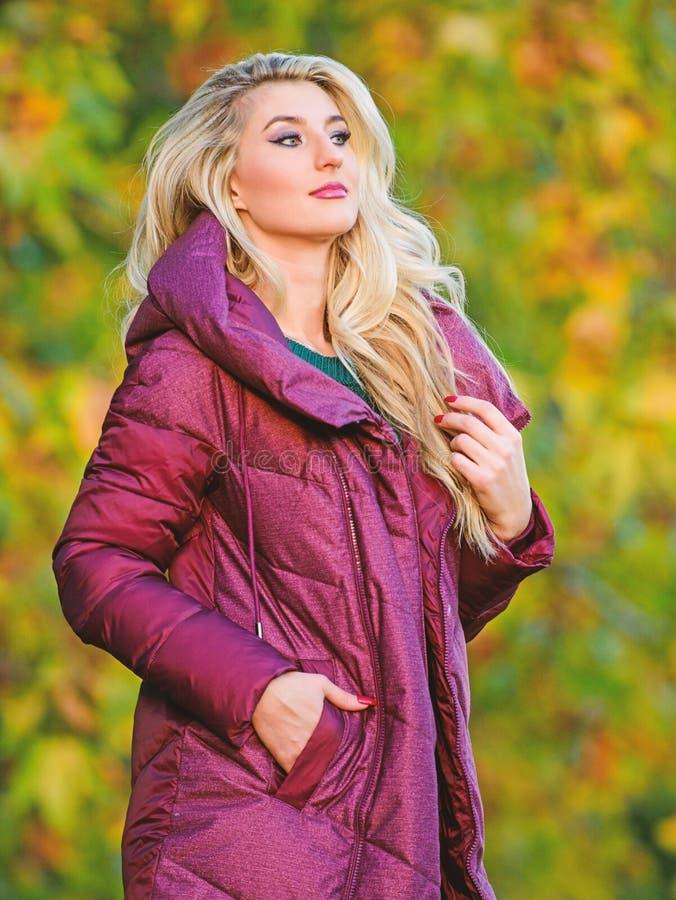 Professional stylist advice. Woman wear extra volume jacket. Girl fashionable blonde walk autumn park. Jackets everyone stock image