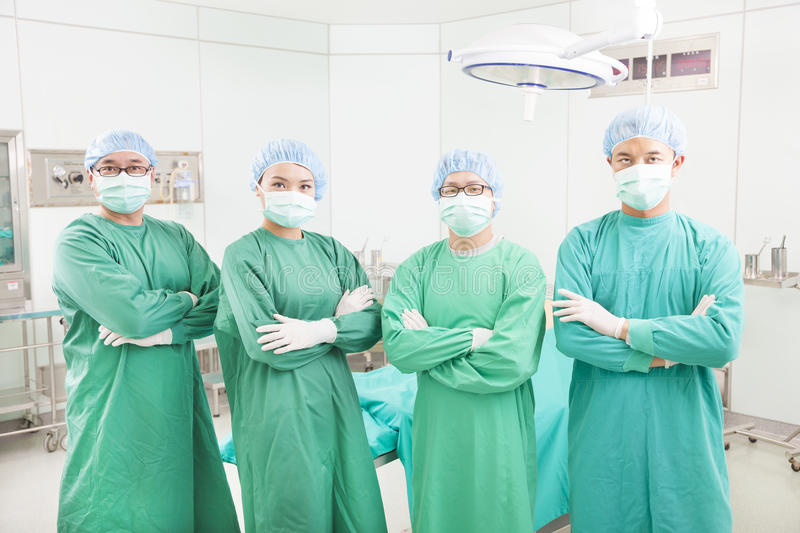 Download Professional Surgeon Teams Standing In A Surgical Room Stock Image - Image: 38333227