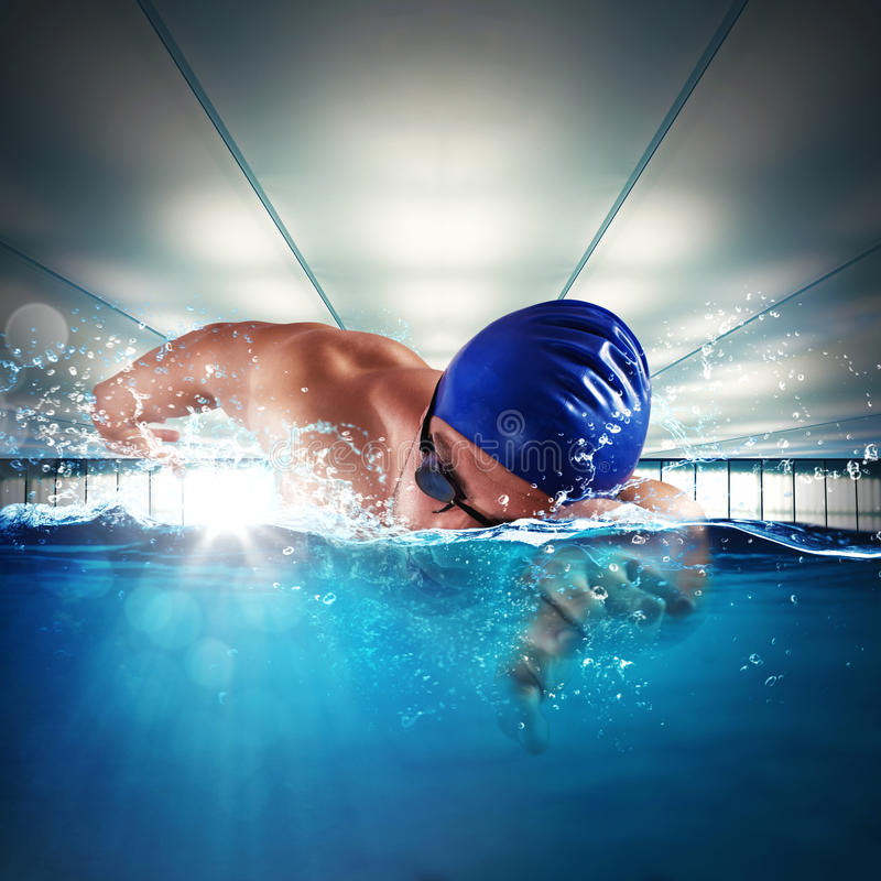 Professional swimmer. Man professional swimmer swimming in a pool stock photo