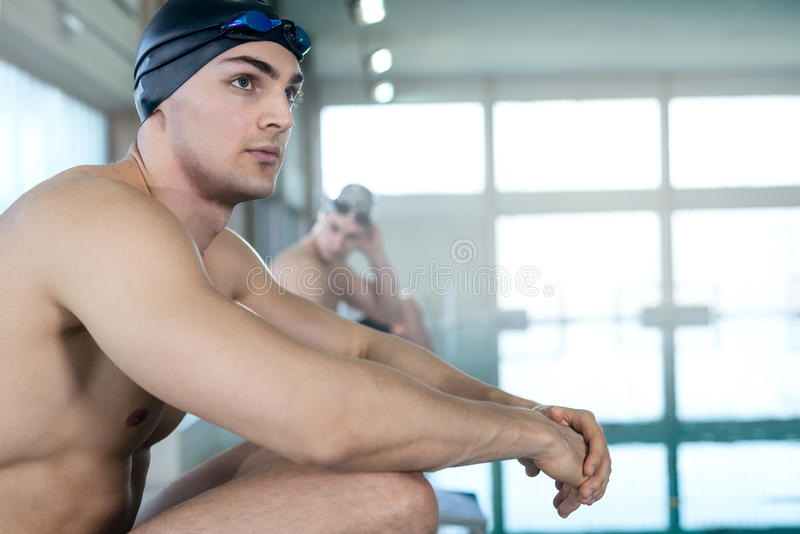 Professional swimmers waiting for the start royalty free stock photography