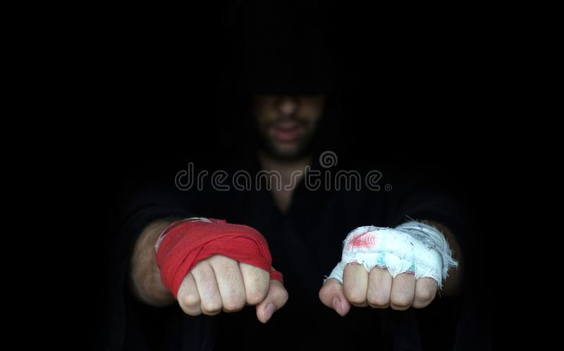 Professional taping and dabbler taping. Boxers fists comparison.  royalty free stock photo